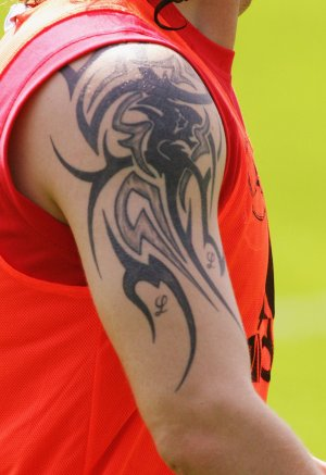 Im diggin the roman numerals on his arm, it seems like any footballer in